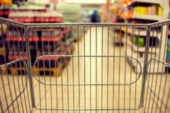Abstract blurred photo of store with food trolley at a supermarket stock images