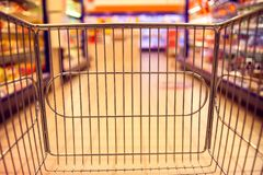 Abstract blurred photo of store with food trolley at a supermarket royalty free stock images