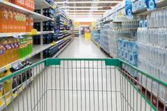 Abstract blurred photo of store with trolley in department store stock photo