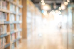 Abstract blurred public library interior background. Abstract blurred public library interior space. blurry room with bookshelves by defocused effect. use for royalty free stock photography