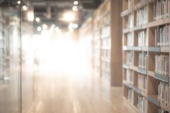 Abstract blurred public library interior background. Abstract blurred public library interior space. blurry room with bookshelves by defocused effect. use for stock image