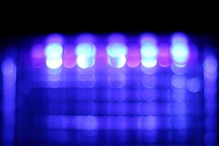 Abstract blurred purple bokeh on black background. Royalty Free Stock Photo