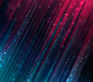 Abstract blurred rays of blue and purple color background. Abstract blurred rays of blue and purple color moving opposite each other with colorful bokeh Royalty Free Stock Photos