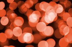 Abstract blurred of red glittering shine bulbs lights background. Blur of Christmas wallpaper decorations concept.  Royalty Free Stock Image