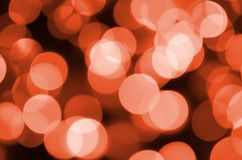 Abstract blurred of red glittering shine bulbs lights background. Blur of Christmas wallpaper decorations concept. Abstract blurred of red glittering shine Stock Images