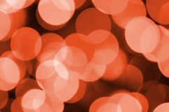 Abstract blurred of red glittering shine bulbs lights background. Blur of Christmas wallpaper decorations concept.  Stock Photos