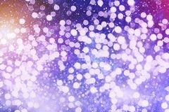 Abstract blurred and silver glittering shine bulbs lights background:blur of Christmas wallpaper decorations concept.holiday festi Stock Photo