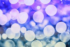 Abstract blurred and silver glittering shine bulbs lights background:blur of Christmas wallpaper decorations concept.holiday festi. Glittering shine bulbs lights Royalty Free Stock Photography