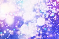 Abstract blurred and silver glittering shine bulbs lights background:blur of Christmas wallpaper decorations concept.holiday festi. Glittering shine bulbs lights Stock Images