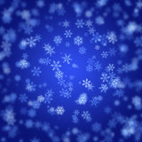 Abstract blurred snowflakes background Stock Image