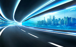 Abstract blurred speed motion road in glass tunnel Royalty Free Stock Photography