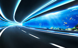 Abstract blurred speed motion road in glass tunnel Royalty Free Stock Image