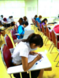 Abstract blurred  students  doing examination in study room Royalty Free Stock Photo