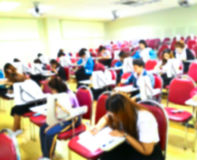 Abstract blurred  students  doing examination in study room Stock Photo