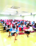 Abstract blurred  students  doing examination in study room Stock Image