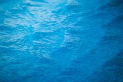 Abstract blurred texture of blue wave water in swimming pool. Selective focus Royalty Free Stock Photos
