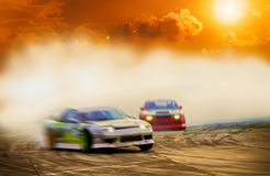 Abstract blurred two drift cars battle with smoke from burned ti stock photos