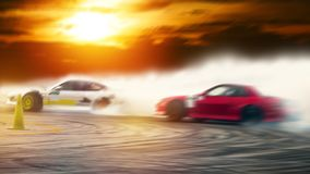 Abstract blurred two drifting cars battle on speed track stock image