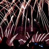 Abstract blurred unrecognizable crowd of young people at concert, show of Fireworks fun of youth, joint leisure Stock Images