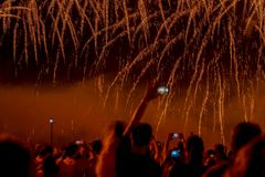 Abstract blurred unrecognizable crowd of young people at concert, show of Fireworks fun of youth, joint leisure Stock Image