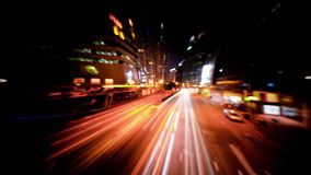 Abstract blurred video of night city traffic across street. Time lapse. Hong Kong stock footage