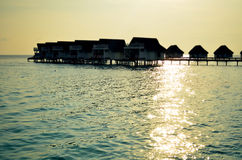 Abstract blurred water villa in sunset time; sunlight bokeh, Mal. Dives royalty free stock image