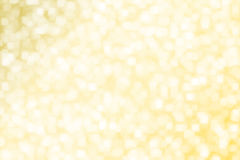 Abstract blurred yellow gold square bokeh background . stock photos