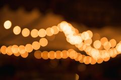Abstract blurred yellow lights on house. Festive illumination royalty free stock images