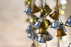 Bell silver and Bell gold Background Blur and Bokeh. Abstract blurry background of gold bell - Image. abstract background bell bells blink blur blurred blurry stock image