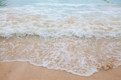 Abstract blurry background of soft wave of blue sea with sandy Royalty Free Stock Photos