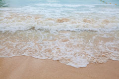 Abstract blurry background of soft wave of blue sea with sandy Royalty Free Stock Image
