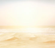 Abstract blurry high key image of empty sand beach Stock Photo