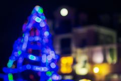 Abstract blurry image of a blue Christmas tree. In the old city center royalty free stock images
