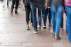 Abstract blurry image of people walking Royalty Free Stock Photography