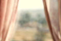 Abstract and blurry image of window with curtains.  Royalty Free Stock Photography