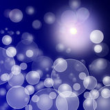 Abstract blurry lights on blue dark background.  Stock Photo