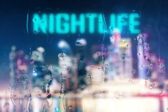 Nightlife concept. Abstract blurry night city background with rain drops on glass and text. Nightlife concept. 3D Rendering vector illustration