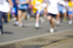 Abstract blury marathon race. Shoot of runner legs Royalty Free Stock Photo