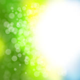 Abstract bokeh background. In green and yellow tones Stock Image