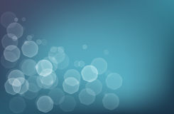 Abstract bokeh background. Abstract aquatic blue bokeh background with glowing sinbeams Royalty Free Stock Photos