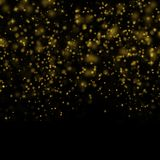Abstract bokeh background, yellow blurred dust with sparkles. Abstract bokeh background, blurred lights. Yellow blurred dust on black with sparkles Stock Images