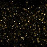 Abstract bokeh background, yellow blurred dust with sparkles. Abstract bokeh background, blurred lights. Yellow blurred dust on black with sparkles Royalty Free Stock Images