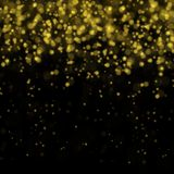 Abstract bokeh background, yellow blurred dust with sparkles. Abstract bokeh background, blurred lights. Yellow blurred dust on black with sparkles Royalty Free Stock Photo