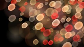 Abstract bokeh background. Abstract background with bokeh effects in red and beige colors Stock Image