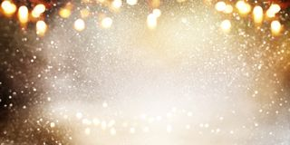Abstract bokeh background in gold and silver stock image