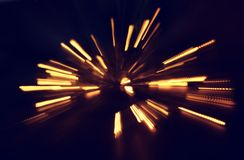 Abstract bokeh background of golden light burst made from bokeh motion.  Stock Photography