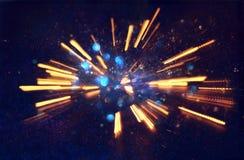 abstract bokeh background of golden light burst made from bokeh motion stock images