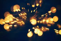 Free Abstract Bokeh Background Of Golden Light Burst Made From Bokeh Motion Stock Image - 102265361