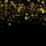 Abstract bokeh background, yellow blurred dust with sparkles. Abstract bokeh background, blurred lights. Yellow blurred dust on black with sparkles Stock Image