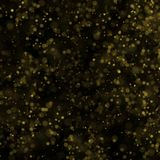 Abstract bokeh background, yellow blurred dust with sparkles. Abstract bokeh background, blurred lights. Yellow blurred dust on black with sparkles Stock Photography